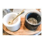 Black and White Marble Salt and pepper Cellars with Brass Spoon on Wood tray
